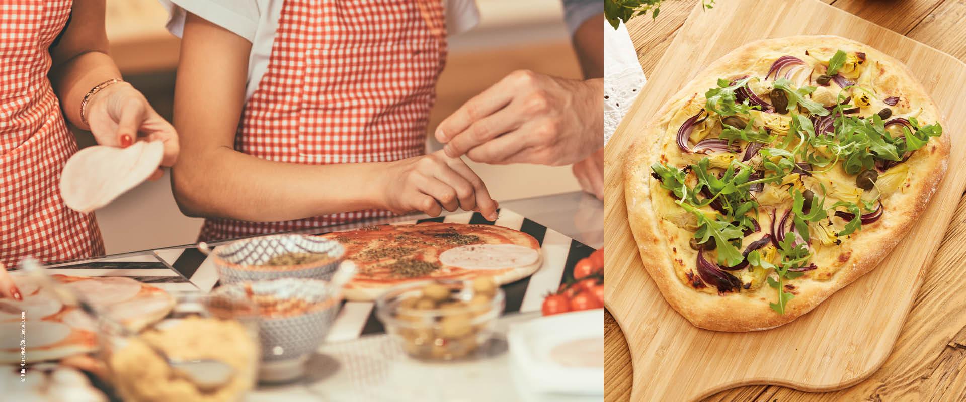 Familie belegt Pizzateig